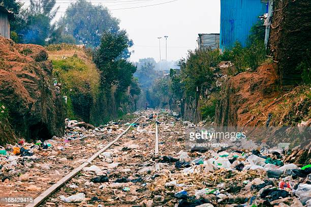 CONTENT] Kibera one of the biggest informal settlements in Africa The Uganda Railway line runs through the heart of Kibera on the outskirts of Nairobi