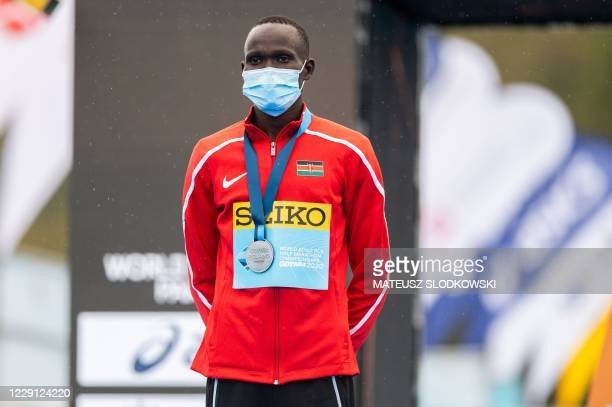 Kibiwott Kandie of Kenya poses with his silver medal on the podium after the men's race of the 2020 IAAF World Half Marathon Championships in Gdynia,...