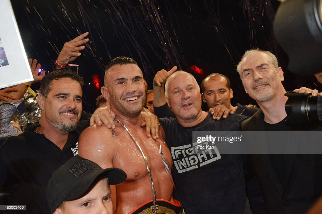 Kick boxing champion Jerome Le Banner (2nd from L), Olivier Muller and guests attend the 'Fight Night 2015' Gala Show at La Citadelle de Saint Tropez on on August 4, 2015 in Saint-Tropez, France.