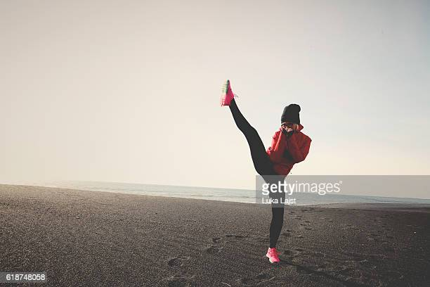 kick boxing on the beach - judo stock photos and pictures