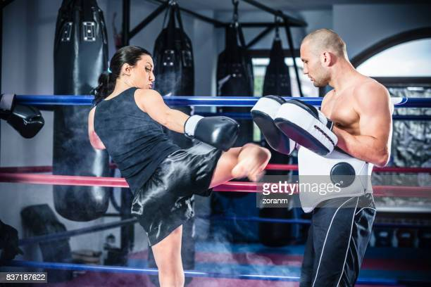 kick jump - muay thai stock pictures, royalty-free photos & images