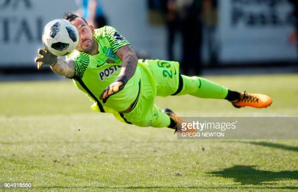 A kick just gets past the outstretched arm of goal keeper Christian Vargas of Colombian side Atletico Nacional on a second half goal for Brazilian...