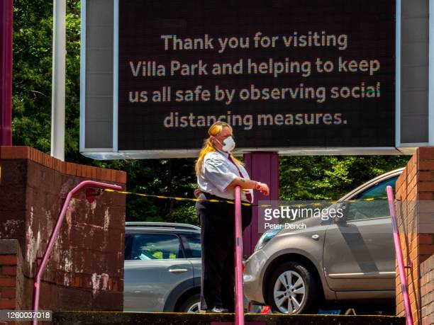 Kick Off 12:30. Aston Villa 0 - 1 Wolverhampton Wanderers. A steward wearing a face mask during the match behind closed doors at Villa Park.