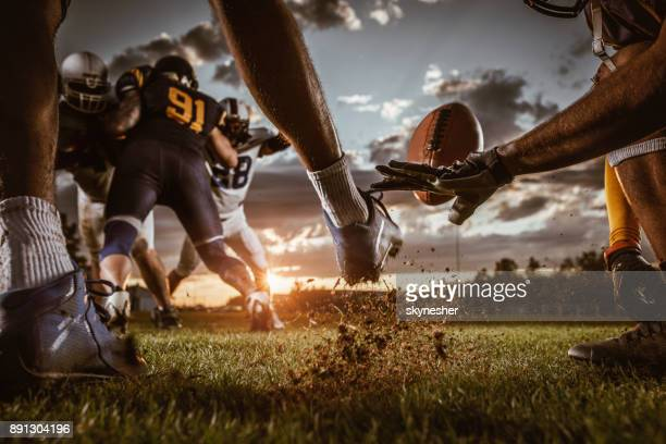 kick off on american football match at sunset! - football league stock pictures, royalty-free photos & images