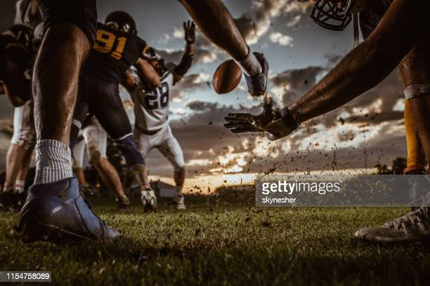 kick off on american football match! - punt kick stock pictures, royalty-free photos & images