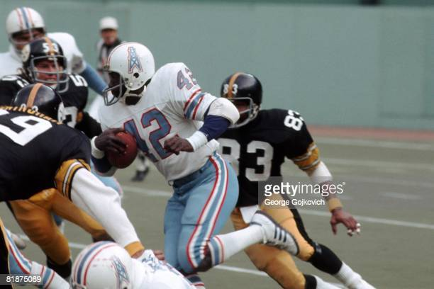 Kick returner Altie Taylor of the Houston Oilers runs with the football during a game against the Pittsburgh Steelers at Three Rivers Stadium on...