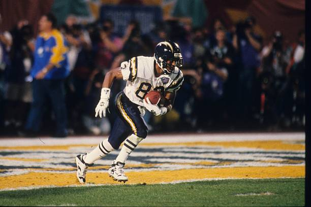 Kick returner Andre Coleman of the San Diego Chargers returns a kick against the San Francisco 49ers in Super Bowl XXIX at Joe Robbie Stadium on...