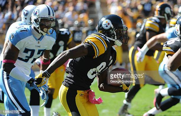 Kick returner Antonio Brown of the Pittsburgh Steelers is pursued by defensive back Tommie Campbell of the Tennessee Titans during a game at Heinz...