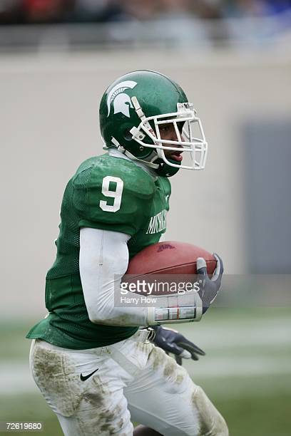Kick returner Demond Williams of the Michigan State Spartans carries the ball against the Minnesota Golden Gophers at Spartan Stadium on November 11,...