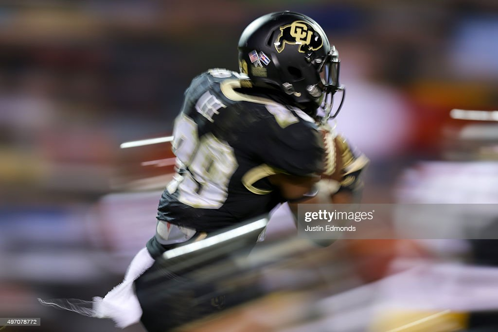 Kick returner Donovan Lee #29 of the Colorado Buffaloes returns a kickoff during the third quarter against the USC Trojans at Folsom Field on November 13, 2015 in Boulder, Colorado. The Trojans defeated the Buffaloes 27-24.
