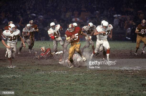 Kick returner Eddie Brown of the Washington Redskins returns a kick in the mud against the St Louis Cardinals at RFK Stadium on October 25 1976 in...