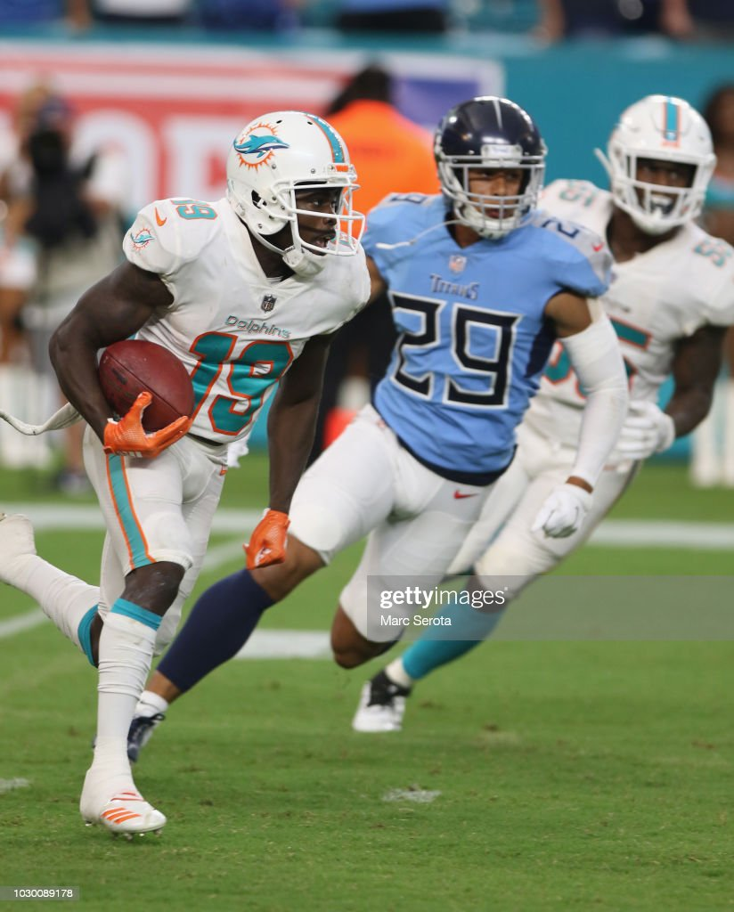 Kick Returner Jakeem Grant #19 of the Miami Dolphins runs back a 101 yard kickoff for a touchdown against the Tennessee Titans at Hard Rock Stadium on September 9, 2018 in Miami, Florida.