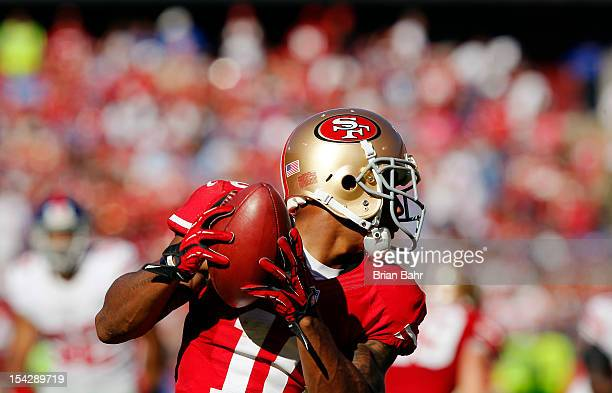 Kick returner Kyle Williams of the San Francisco 49ers catches the ball against the New York Giants for a 19yard return in the third quarter on...