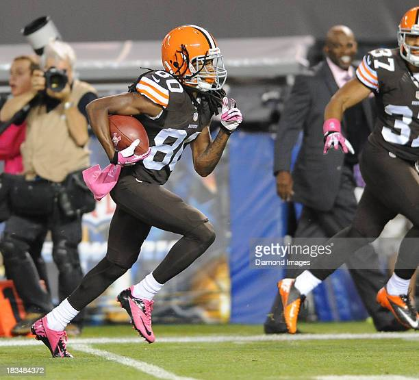 Kick Returner Travis Benjamin of the Cleveland Browns returns a punt for a touchdown during a game against the Buffalo Bills at FirstEnergy Stadium...