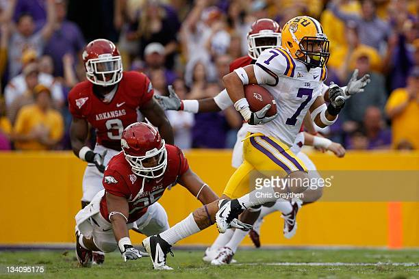 Kick returner Tyrann Mathieu of the LSU Tigers returns a punt 92yards for a second quarter touchdown against the Arkansas Razorbacks at Tiger Stadium...