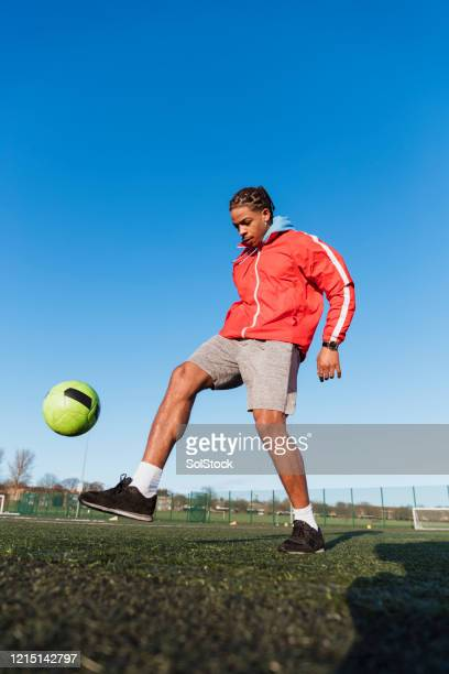 kickabout on the pitch - football player stock pictures, royalty-free photos & images