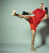 kickboxer beats with his foot black