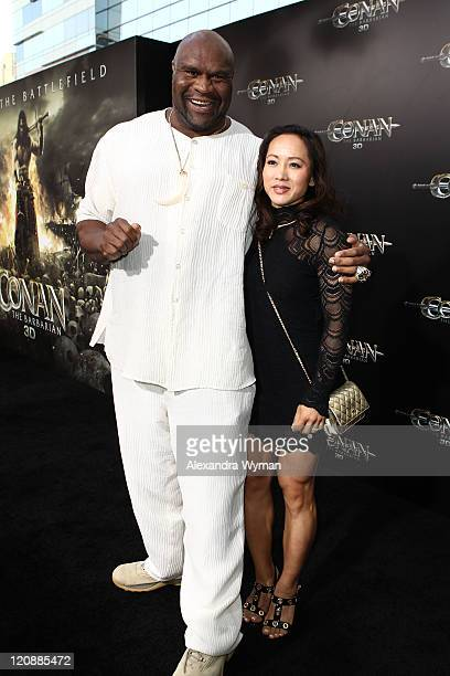 Kickboxer Bob Sapp and guest attend the world premiere of Conan The Barbarian held at Regal Cinemas LA Live on August 11 2011 in Los Angeles...