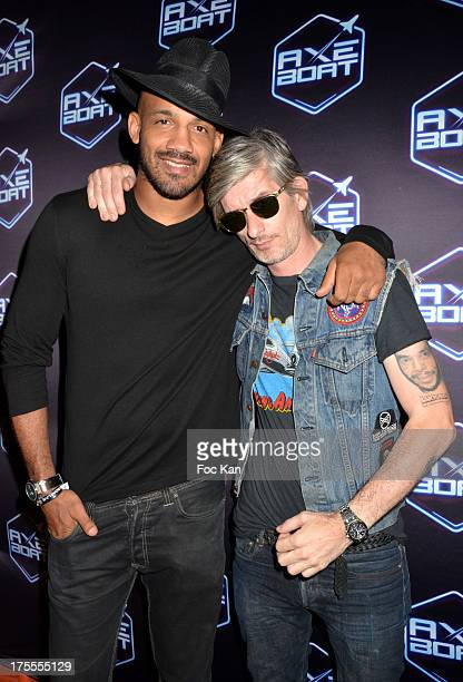 Kickboxer Cyrille Diabate and Kavinsky attend the Axe Boat 2013 Launch Party at Cannes Harbourg on August 3 2013 in Saint Tropez France