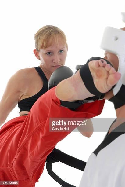 Kickboxer executing a roundhouse kick.