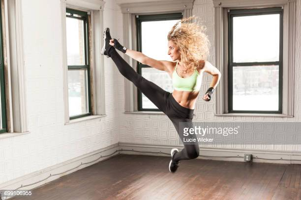 kickboxer jump - kickboxing stock pictures, royalty-free photos & images