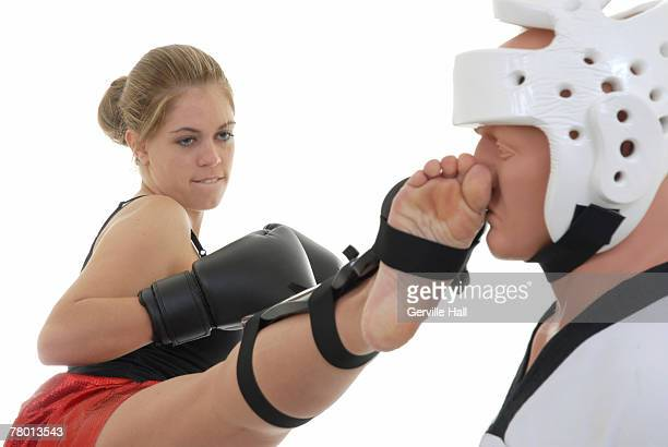 Kickboxer sparring to workout.