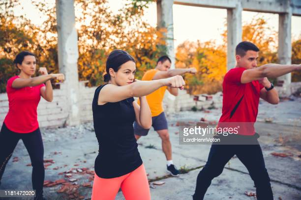 kickboxing class outdoor - martial arts stock pictures, royalty-free photos & images