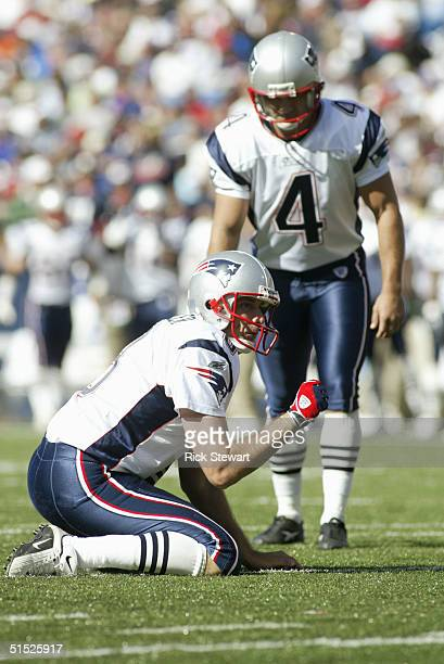Kicker Adam Vinatieri gets ready to kick from the hold of Punter Josh Miller of the New England Patriots during the game with the Buffalo Bills on...