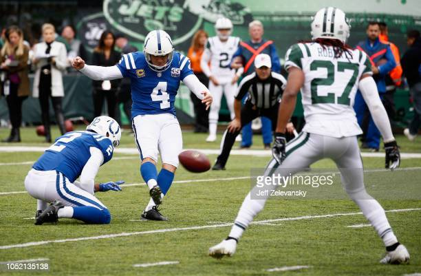 Kicker Adam Vinatieri of the Indianapolis Colts kicks a ball placed by teammate punter Rigoberto Sanchez against the New York Jets during the second...