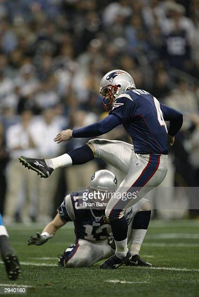 Kicker Adam Vinatieri of the New England Patriots attempts to score off a hold from punter Ken Walter during Super Bowl XXXVIII against the Carolina...