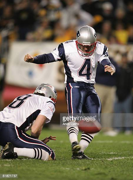 Kicker Adam Vinatieri of the New England Patriots attempts to score off a hold by punter Josh Miller during the game against the Pittsburgh Steelers...