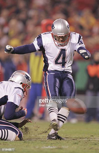 Kicker Adam Vinatieri of the New England Patriots attempts to score an extra point of a hold by punter Josh Miller during the game against the Kansas...
