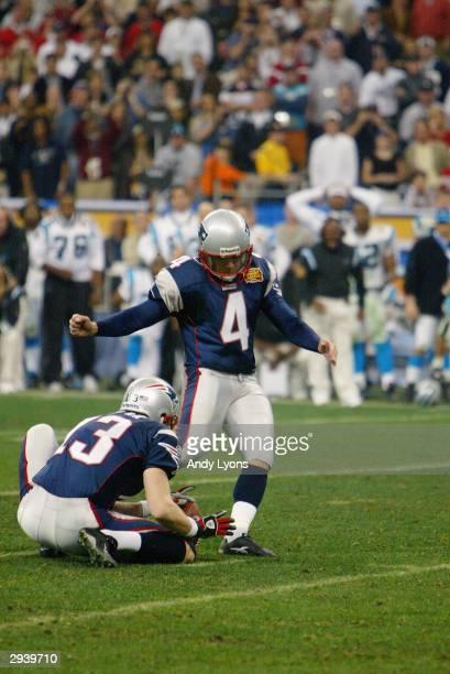 Kicker Adam Vinatieri of the New England Patriots kicks a field goal attempt against the Carolina Panthers during Super Bowl XXXVIII at Reliant...