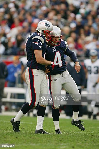 Kicker Adam Vinatieri of the New England Patriotscelebrates with punter Josh Miller during the game with the Seattle Seahawks at Gillette Stadium on...