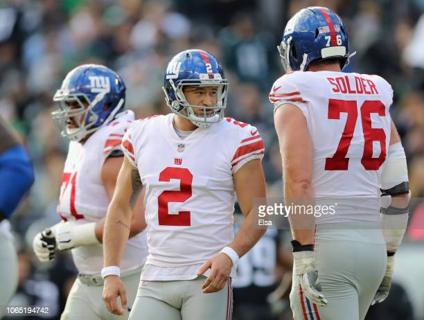 Kicker Aldrick Rosas of the New York Giants celebrates a field goal with teammate offensive tackle Nate Solder against the Philadelphia Eagles during...
