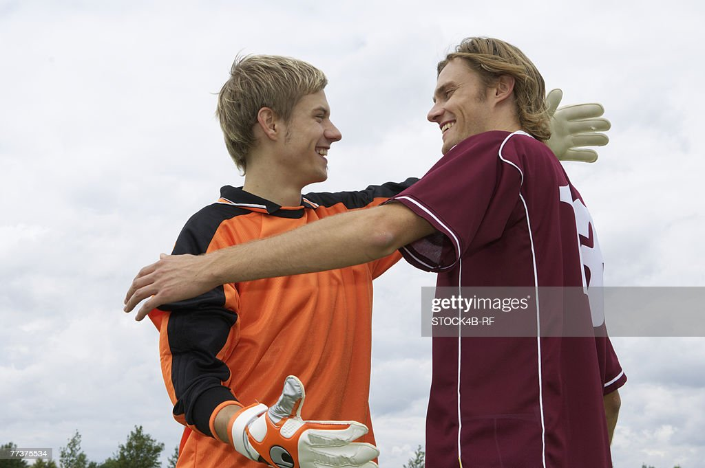 Kicker and goalkeeper embracing each other : Photo