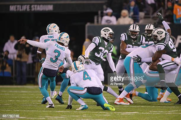 Kicker Andrew Franks of the Miami Dolphins kicks an extra point against the New York Jets at MetLife Stadium on December 17 2016 in East Rutherford...