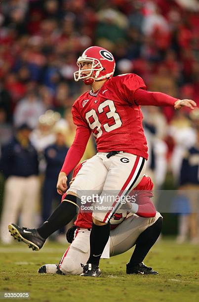 Kicker Andy Bailey of the Georgia Bulldogs attempts a kick against the Georgia Tech Yellow Jackets during the game at Sanford Stadium on November 27,...