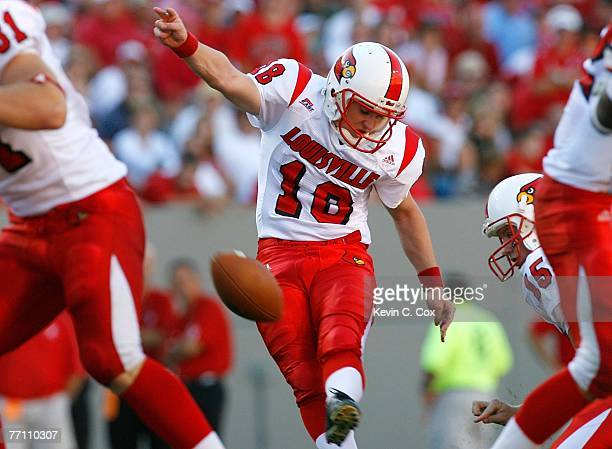 Kicker Art Carmody of the Louisville Cardinals successfully kicks a field goal against the North Carolina State Wolfpack during the first half at...