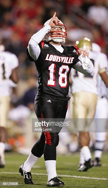 Kicker Arthur Carmody of the Louisville Cardinals points to the sky during the game against the Pittsburgh Panthers at Papa John's Stadium on...