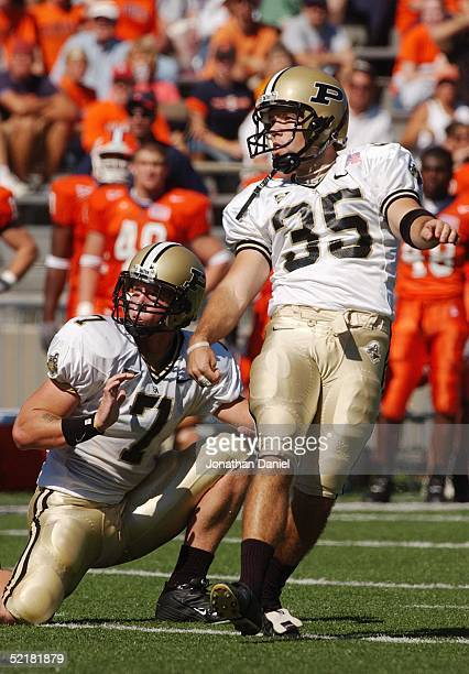 Kicker Ben Jones of the Purdue University Boilermakers and free safety Kyle Smith watch the ball during the game against the University of Illinois...