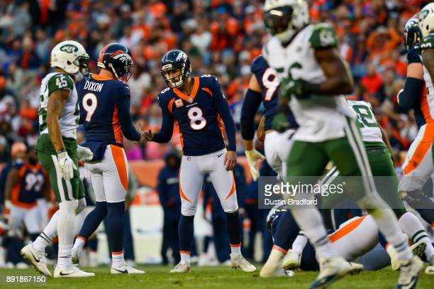 Kicker Brandon McManus of the Denver Broncos celebrates a fourth quarter field goal with Riley Dixon during a game against the New York Jets at...
