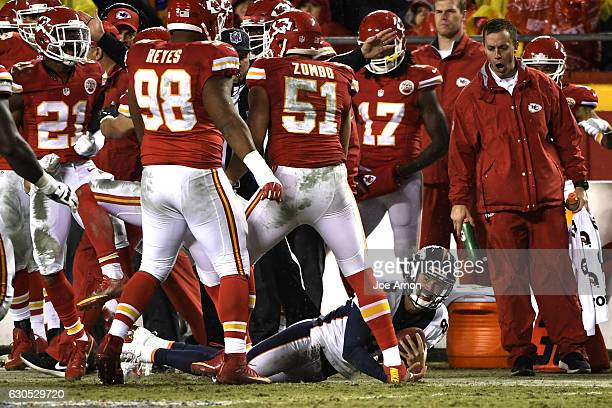 Kicker Brandon McManus of the Denver Broncos hopes for a musical as he tried to run for a first down in the second quarter at Arrowhead Stadium...
