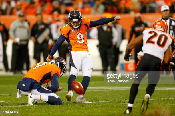 Kicker Brandon McManus of the Denver Broncos kicks a third quarter field goal against the Cincinnati Bengals at Sports Authority Field at Mile High...