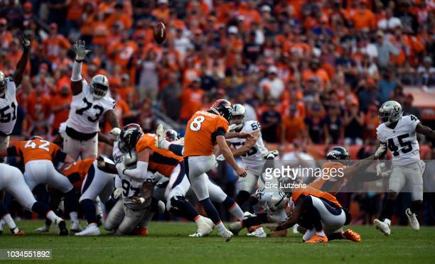 Kicker Brandon McManus of the Denver Broncos kicks the game winning field goal during the fourth quarter on Sunday September 16 at Broncos Stadium at...