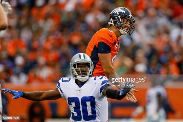 Kicker Brandon McManus of the Denver Broncos reacts as cornerback Anthony Brown of the Dallas Cowboys signals that the field goal is no good int he...