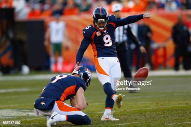 Kicker Brandon McManus of the Denver Broncos successfully kicks a 52yard field goal on a hold from Riley Dixon during the second quarter against the...