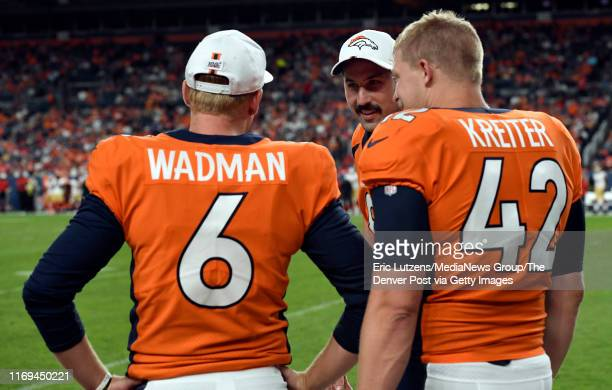 Kicker Brandon McManus of the Denver Broncos talks with punter Colby Wadman and long snapper Casey Kreiter of the Denver Broncos during the third...