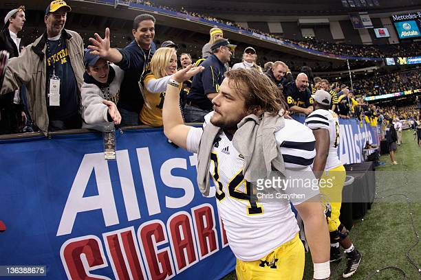 Kicker Brendan Gibbons of the Michigan Wolverines celebrates with fans after Michigan won 2320 in overtime on Gibbons 37yard gamewinning field goal...