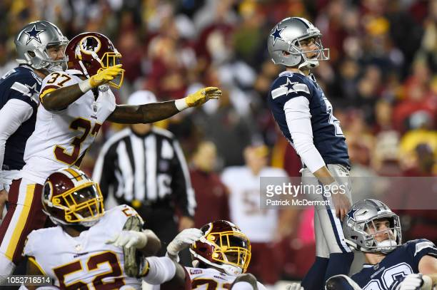 Kicker Brett Maher of the Dallas Cowboys reacts after missing a field goal at the end of the fourth quarter against the Washington Redskins at...